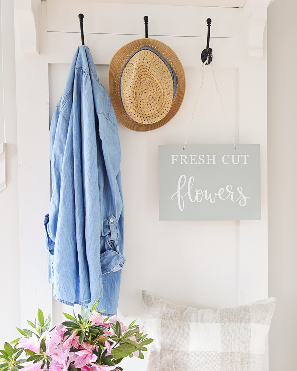 hanging spring wood sign in entryway
