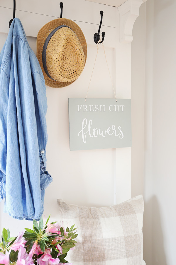 mint spring wood sign hanging on hall tree