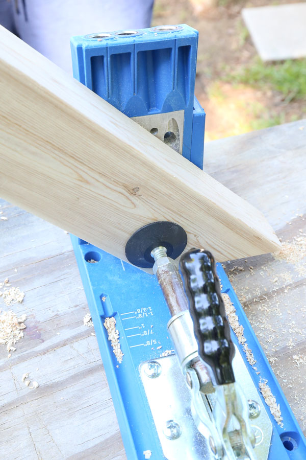Use a Kreg Jig and add one pocket hole to angled short board