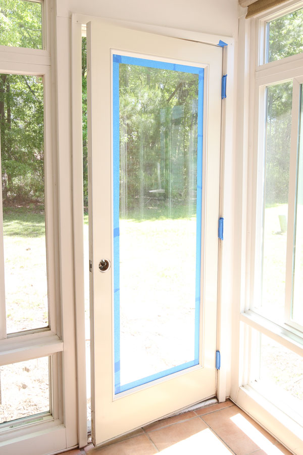 apply painter's tape around door edges for how to paint a metal door