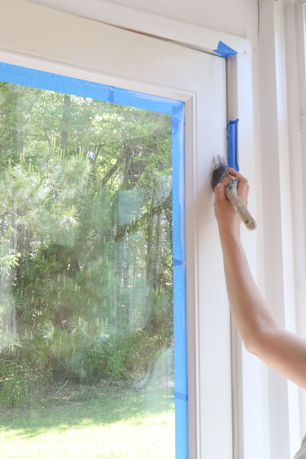 use paint brush and cut in edges and creases with primer on door