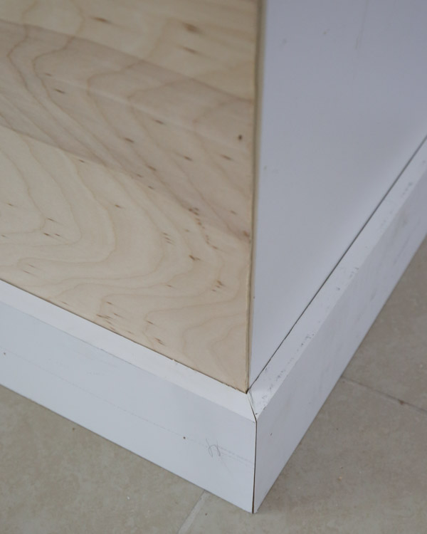 kitchen island baseboard corners lined up with a bevel cut