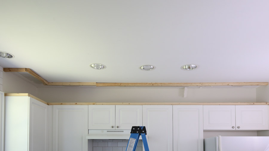 framing out the empty space above the kitchen cabinets to the enclose the space
