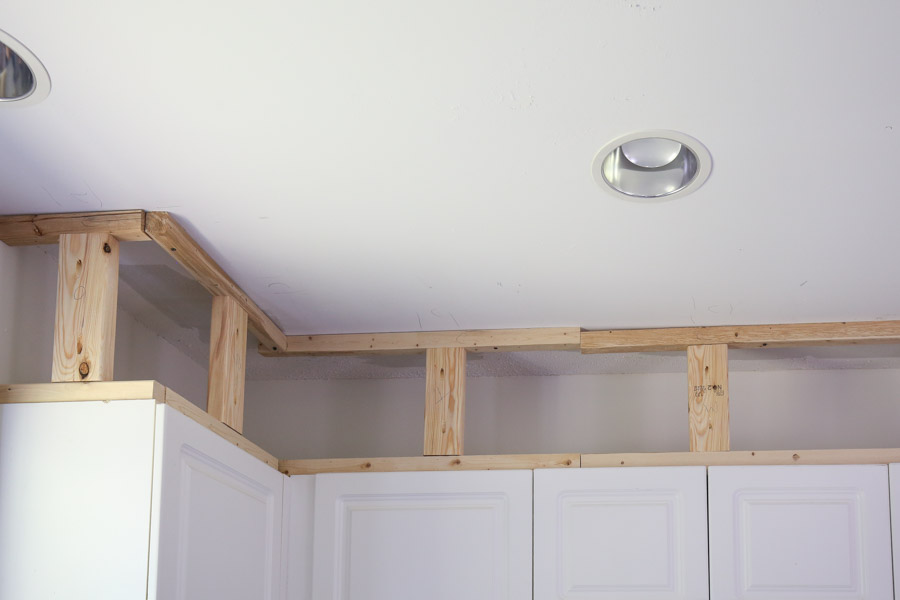 Add 2x4 wood blocks to frame boards above cabinets