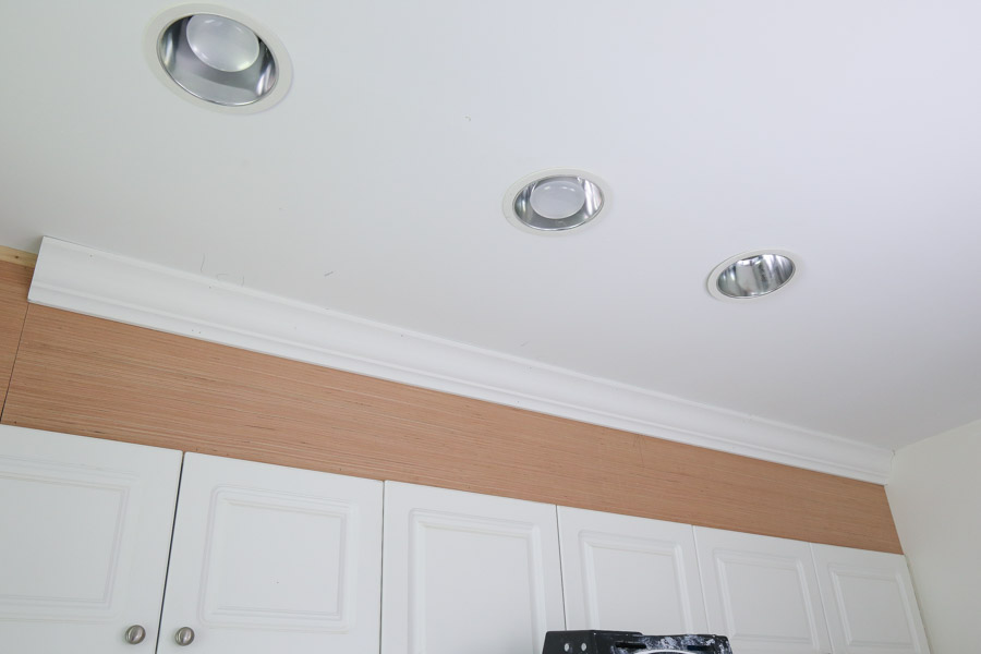 attach crown molding to ceiling and cabinet enclosure