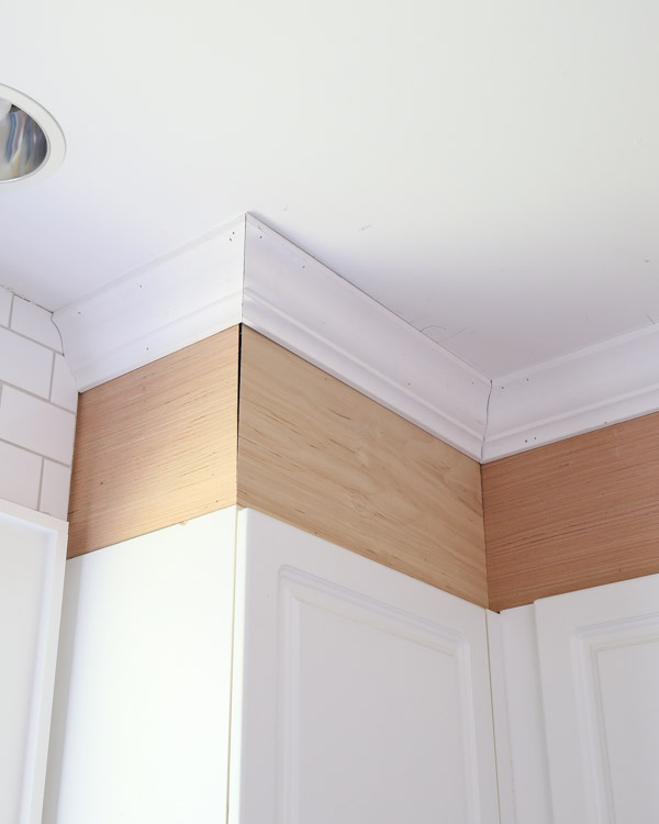 attach crown molding around corner cabinet