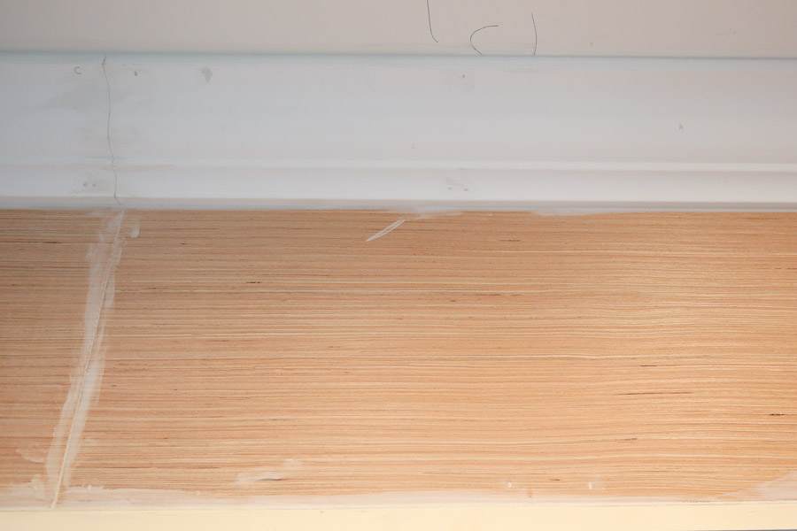 Caulk and fill nail holes with spackle