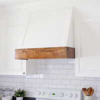 DIY Range Hood Cover with stained wood and white paint