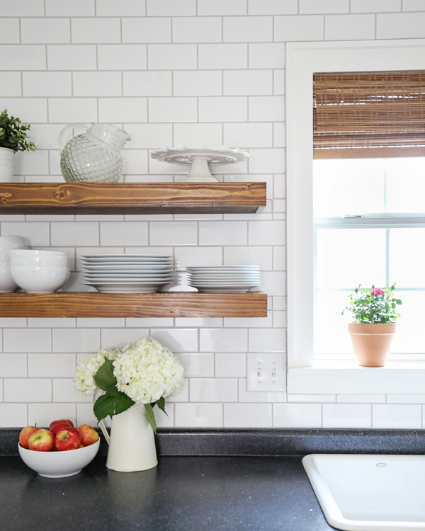 wood kithcen floating shelves and subway tile with warm gray grout