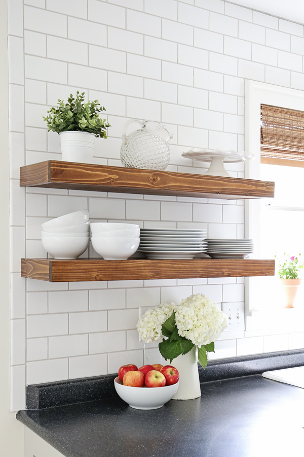 wood kitchen floating shelves with subway tile