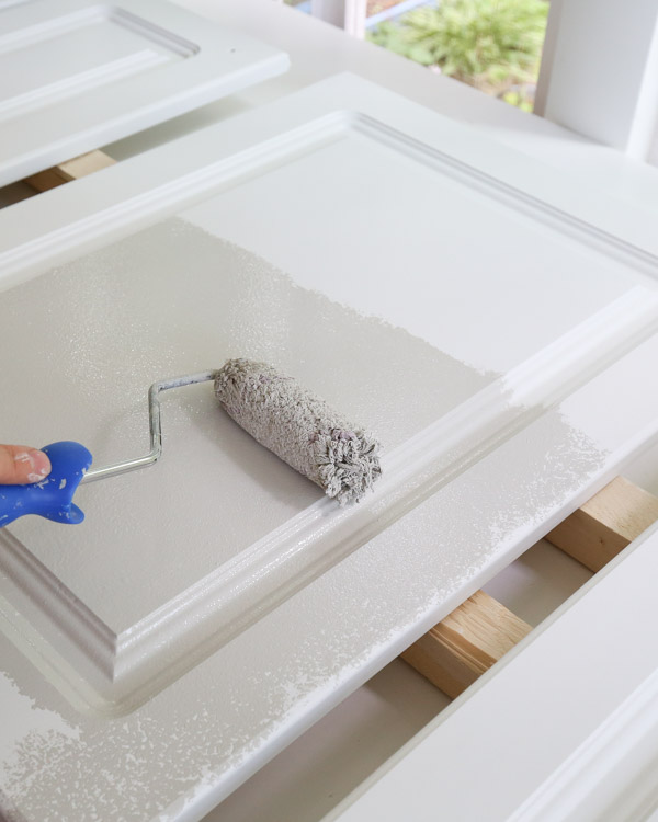 painting kitchen cabinets with a paint roller