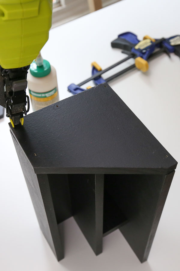 attach sides of DIY wooden desk organizer with brad nailer