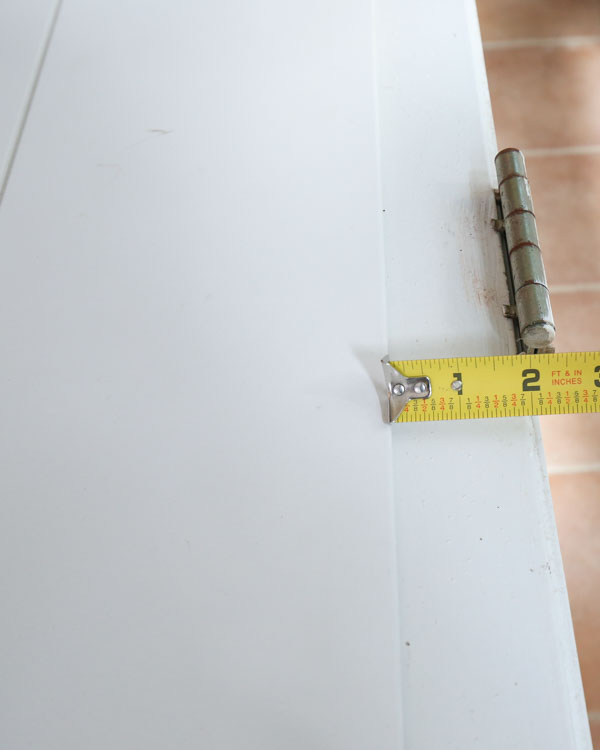 measuring extra space between shiplap boards and door hinges