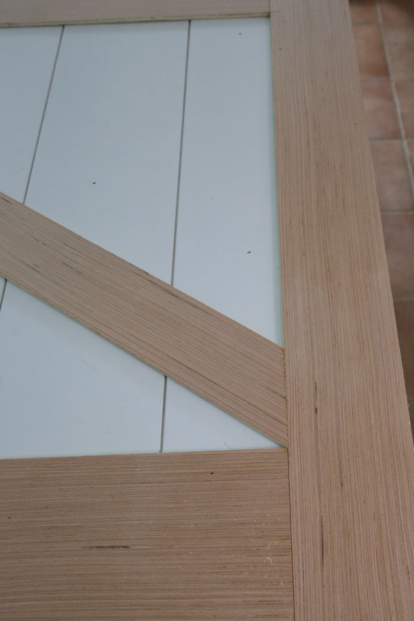installing angled barn door trim boards