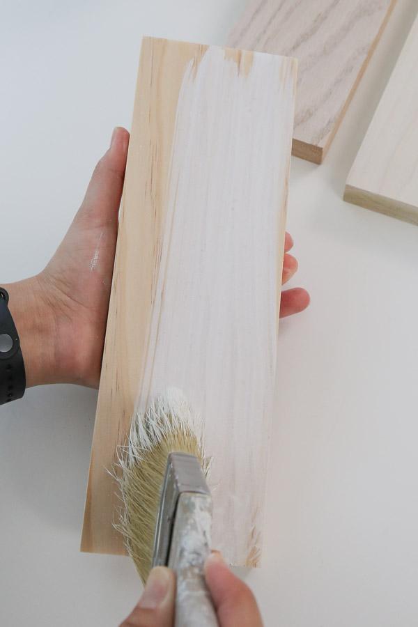 applying whitewash to raw wood