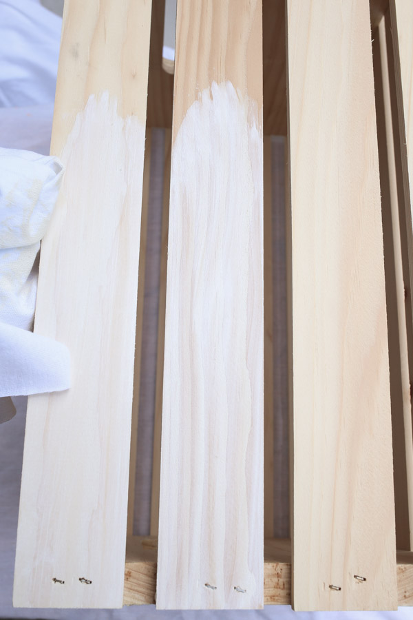 whitewash paint application on unfinished wood crate