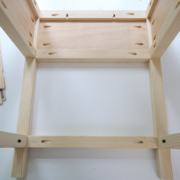 assemble back of nightstand to side frames