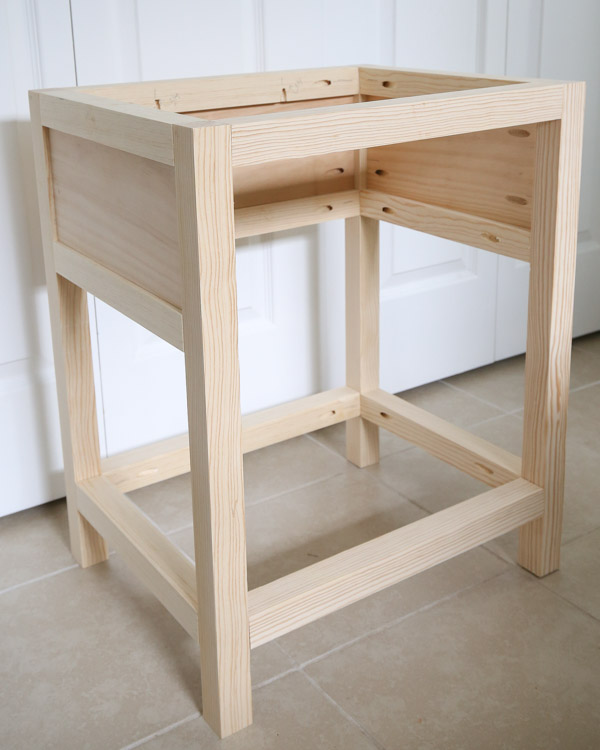 add front 2x2 boards to conntect front of nightstand to side frames