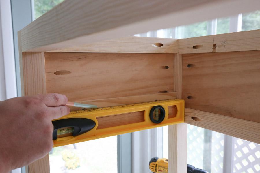 mark line for installing drawer slides using a level