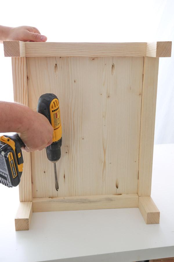 install bottom shelf of nightstand with drill and kreg screws