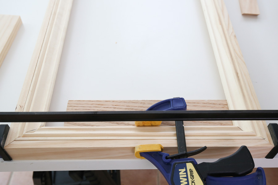 "adding 1/2"" thick wood to molding frame with clamps and brad nails"