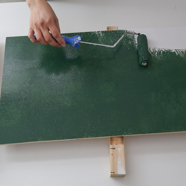 painting the diy wooden christmas sign green