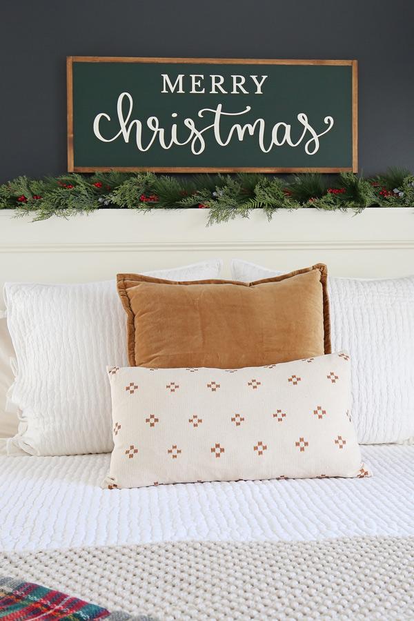 Wood DIY Christmas sign in cozy bedroom