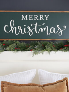 diy wooden christmas sign over bed