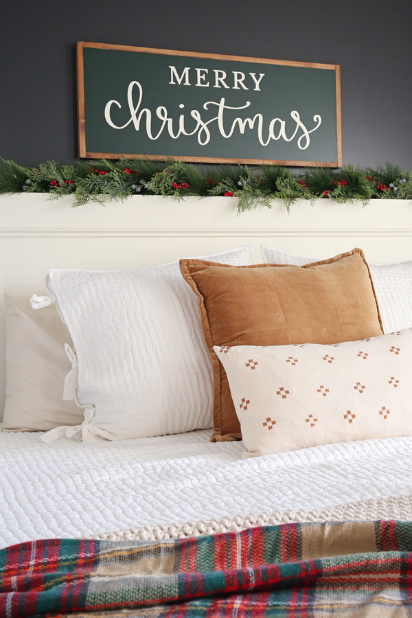 Merry Christmas sign DIY over bed with garland