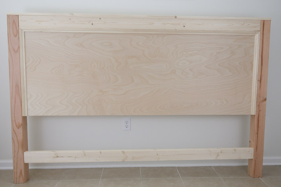front of DIY headboard with trim