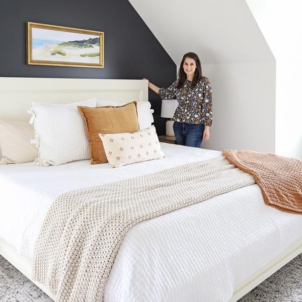 standing next to DIY bedframe