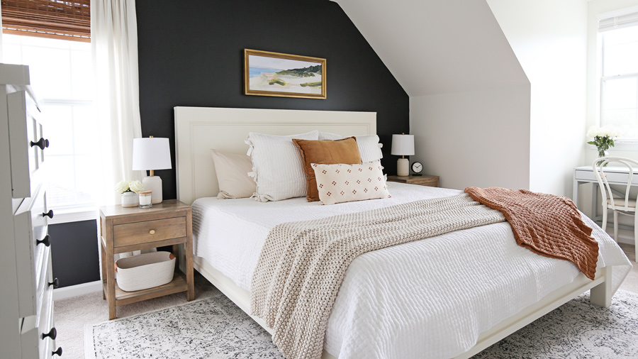 DIY bedroom makeover with DIY king bed frame and DIY nightstands and black accent wall