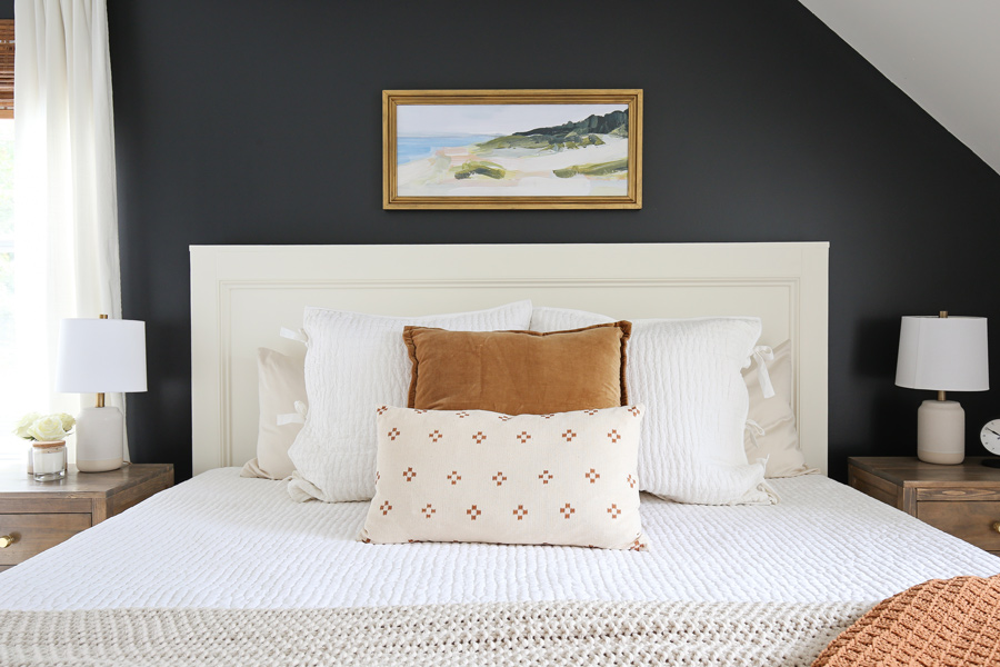 cozy white, brown, and natural bedding in DIY bedroom makeover