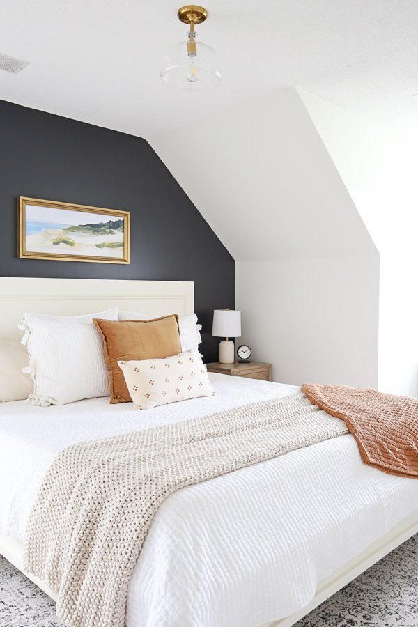 DIY bedroom makeover with DIY king bed frame and cozy bedding