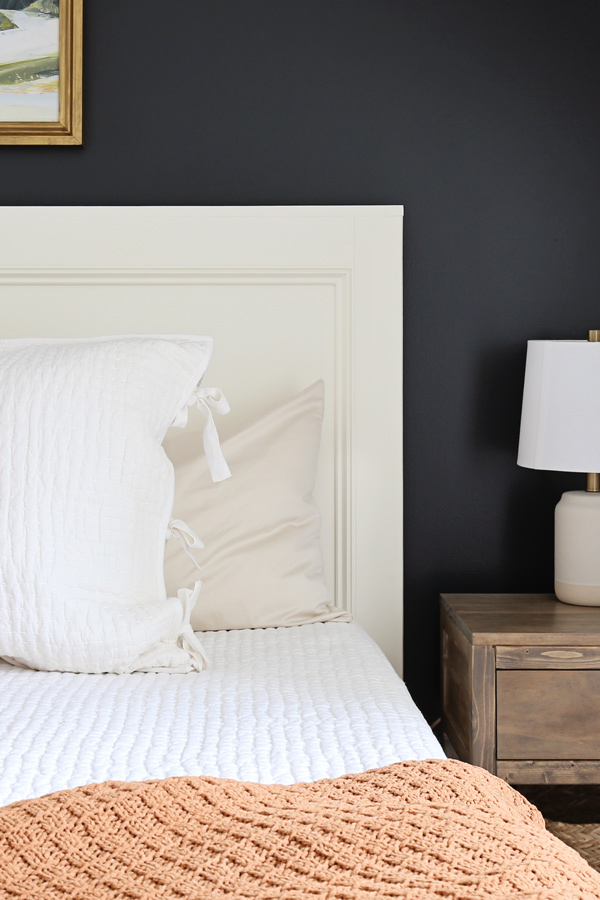 close up of DIY headboard on bed frame