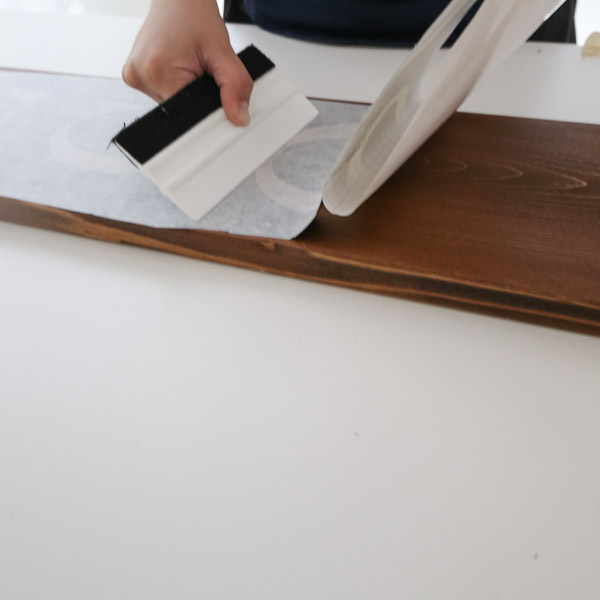 applying vinyl stencil to wood
