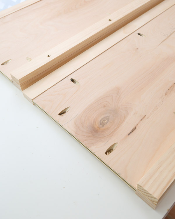 attach bottom 1x2 board to toy box front and back to create bottom slat supports