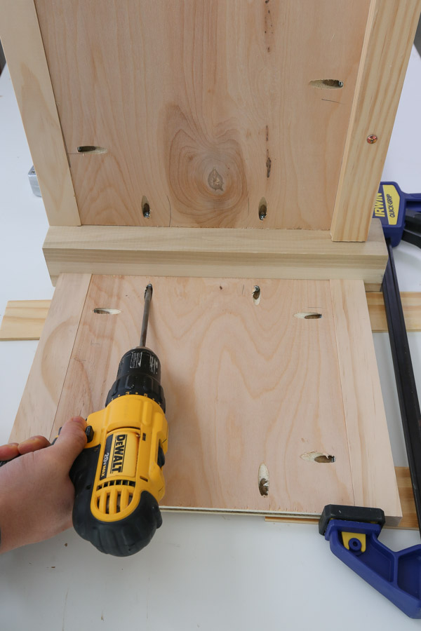 attach sides of diy wooden toy box to legs