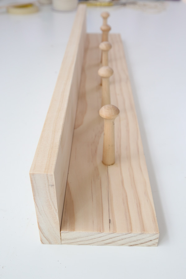 DIY coat rack with shaker pegs unfinished raw wood
