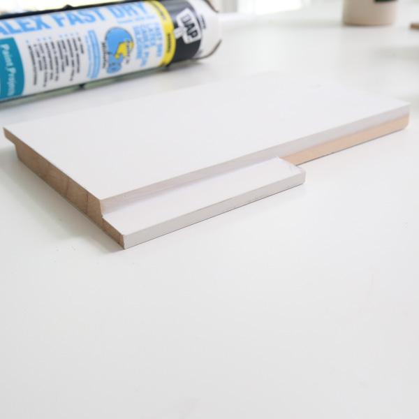 caulk for custom cut shiplap for opening of dog bed