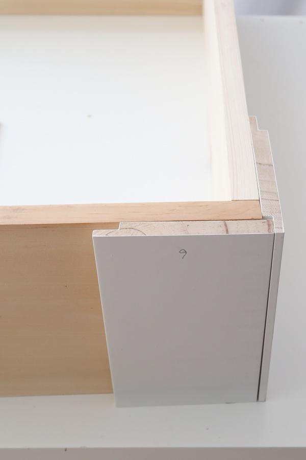 adding vertical shiplap to front right corner of DIY dog bed frame