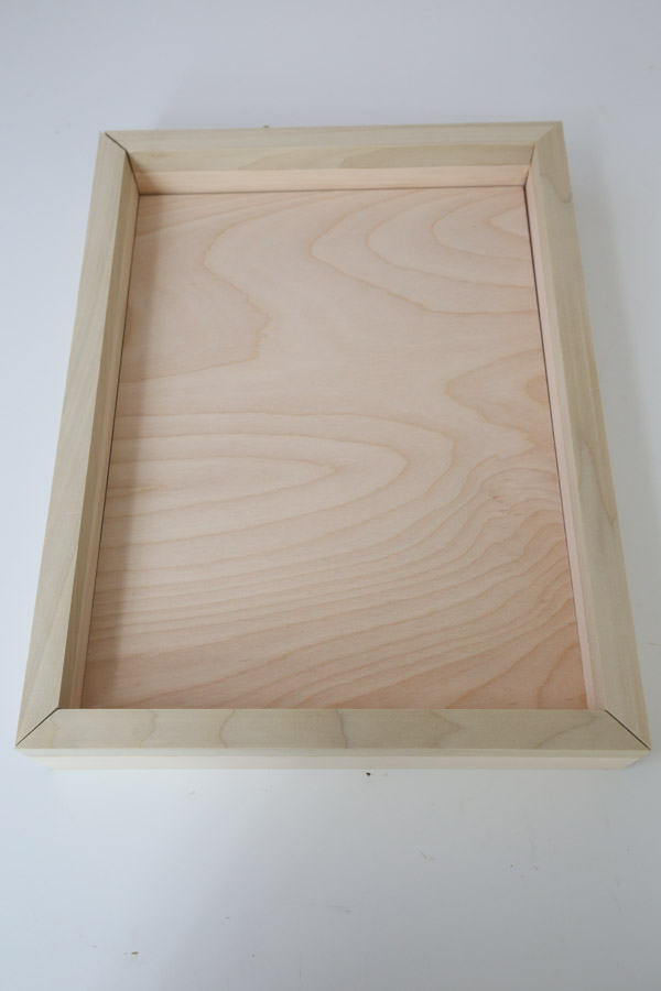 Before assembling the DIY serving tray, line up all of the boards