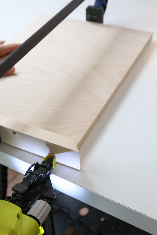 use a brad nailer to attach side 1x2s of serving tray
