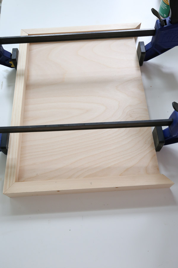use a brad nailer to attach side 1x2s of diy wood serving tray