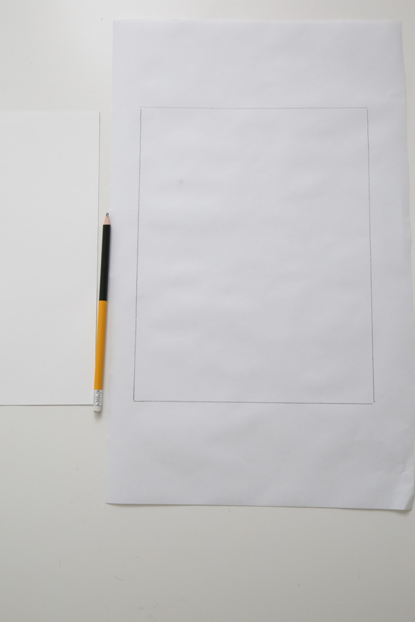 Trace the letter size paper on the freezer paper with a pencil