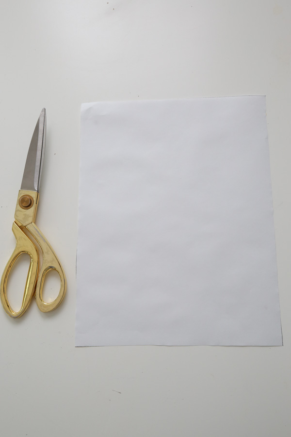 Cut the freezer paper to size with scissors