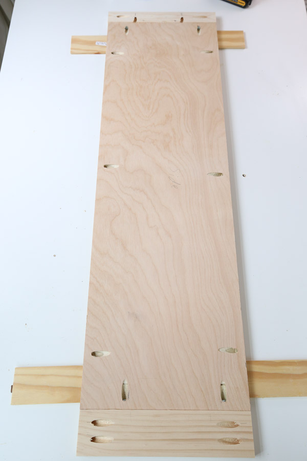 top and bottom trim attached to the plywood sides
