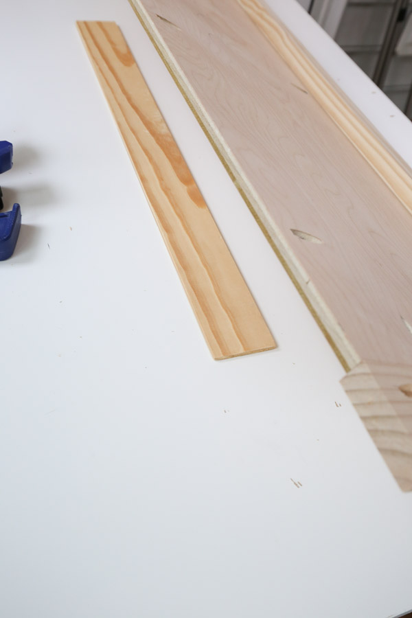 """placing 1/4"""" wood under plywood side to help attach legs"""