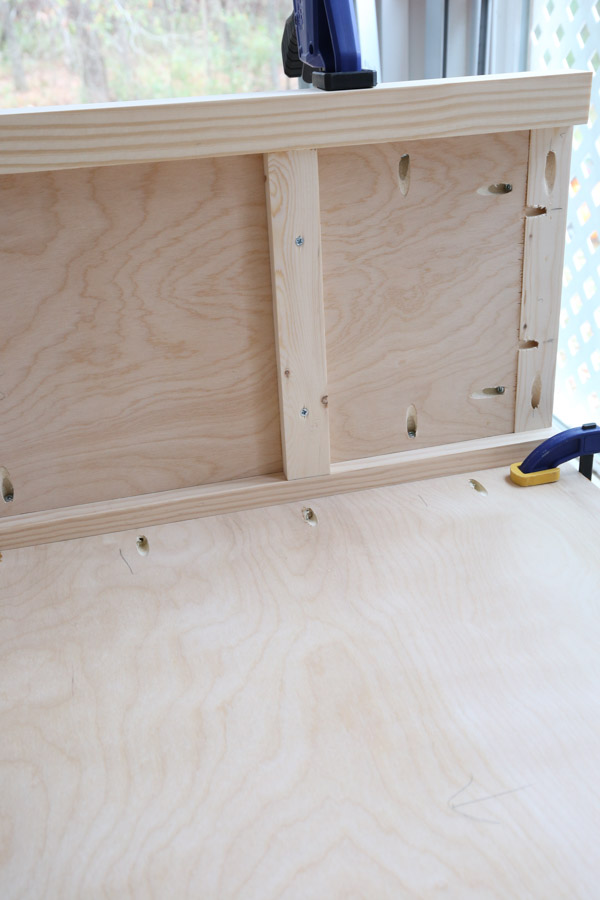 attach backing board to bookshelf sides with Kreg screws