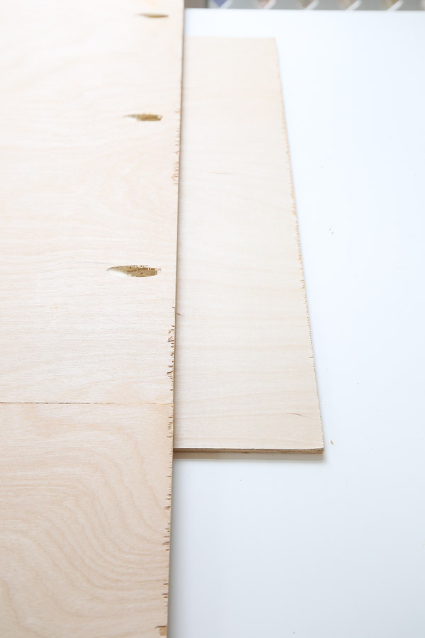 """Place 1/4"""" scrap wood under the plywood backing board sides"""